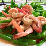 Big Thai shrimp and pak boong as a side dish at a Thai restaurant.