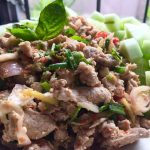 Lahp Moo is one of Thailand's favorite foods. Spicy pork salad with fresh basil leaves.