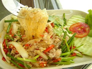 Yum Woonsen is a spicy Thai dish called spicy glass noodle salad.