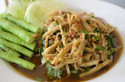 Spicy Thai bamboo salad with green beans and cucumber slices.