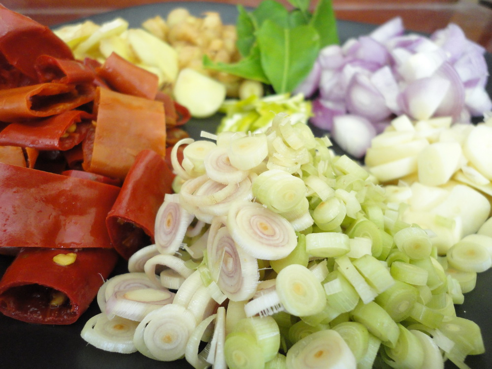 Thai garlic, scallions, other ingredients for Khanom Jeen curry.
