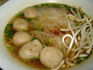 Thai breakfast - gwit diao soup with chicken, pork, or beef and thin or thicker noodles.